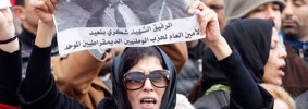 A woman in Tunis at the funeral procession of Chokri Belaid