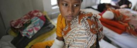 khatun-who-was-rescued-from-the-rubble-of-the-collapsed-rana-plaza-building-sits-on-a-bed-at-enam-me